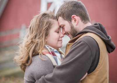 Engagement photography session in front of red barn