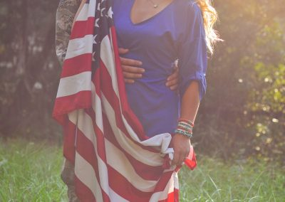engagment photography military couple with America flag
