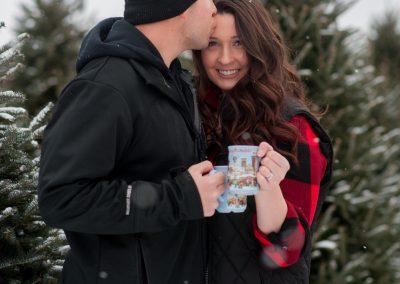 couple enjoying hot cocoa at a Christmas tree farm