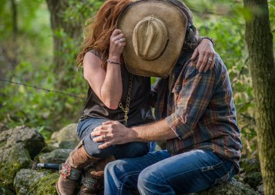 Engagement photography with cowboy hat