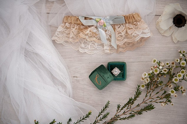 Pretty lay flat of ring, veil and flowers