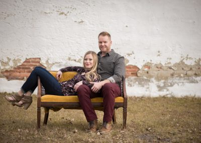 Christmas mini session couple lounging on couch